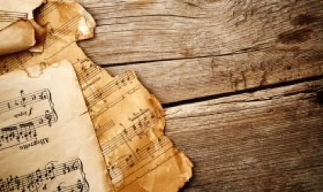 Vintage music notes on the wooden background